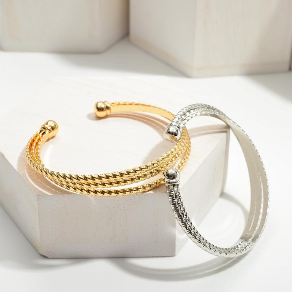 """Metal Cuff Bracelets Featuring Twisted Details.   - Approximately 2.5"""" in Diameter"""