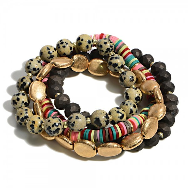 """Set of Four Gold Tone Beaded Stack Bracelets Featuring Heishi and Glass Beads   - Approximately 3"""" Diameter"""