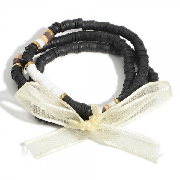 """Three Rubber Heishi Beaded Stretch Bracelets.  - Approximately 3"""" in Diameter"""