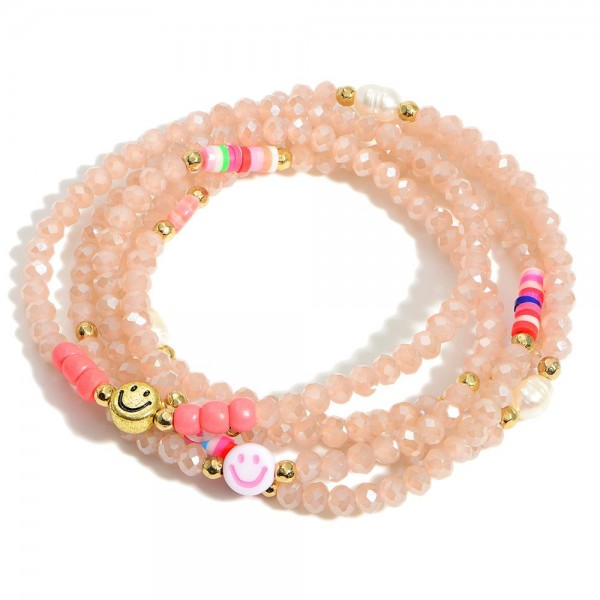 """Set of Five Glass Bead Elastic Bracelets Featuring Smiley Face Accents.  - Approximately 2.5"""" in Diameter"""