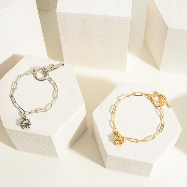 """Simple Gold Tone Chain Link Bracelet Featuring Miniature Bow Charm  - Approximately 3"""" Wide"""