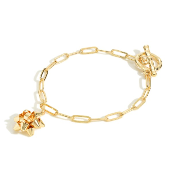 """Simple Gold Tone Chain Link Bracelet Featuring Bow Charm  - Approximately 3"""" Wide"""