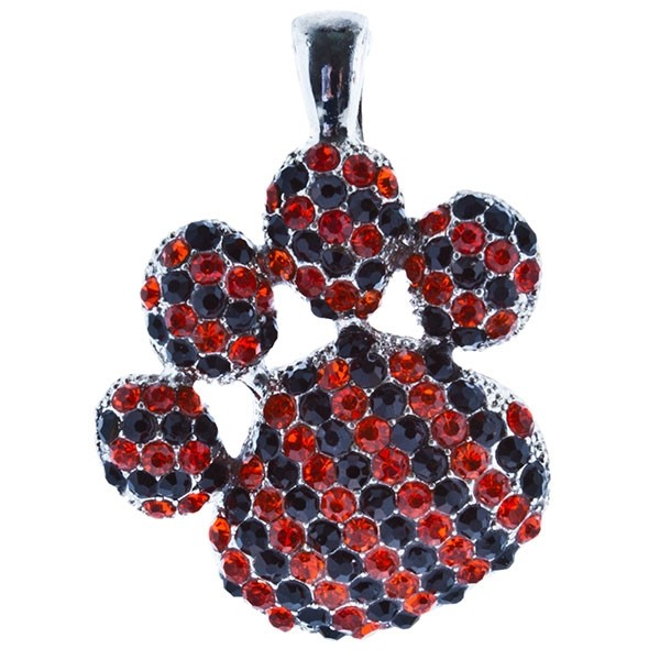 "2 1/2"" Silver tone paw pendant encrusted with orange and black rhinestones."