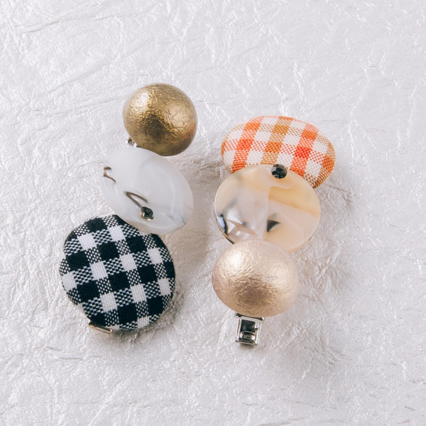 """Hair clip featuring a trio pattern with resin and button details. Approximately 2.25"""" in length."""