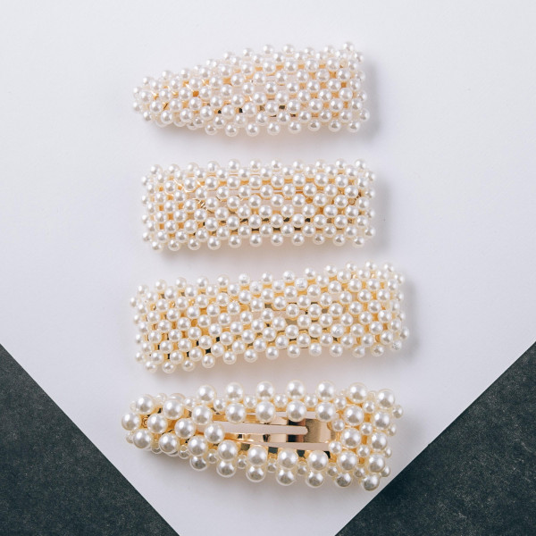 """Gold hair clip featuring pearl beaded details. Approximately 3"""" in length."""