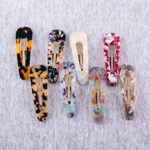 """Hair clip featuring resin inspired details. Approximately 3"""" in length."""
