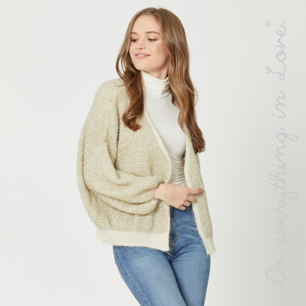 "Do everything in Love brand gold metallic open knit fuzzy cardigan.  - One size fits most 0-14 - Approximately 24"" in length - 100% Polyester"