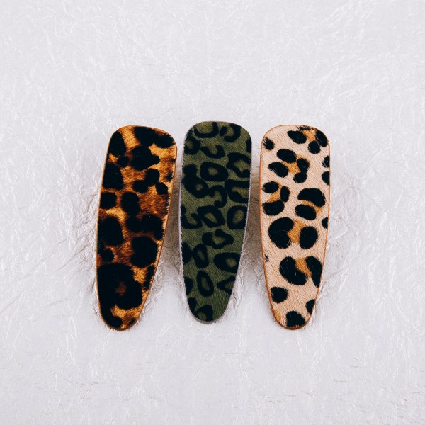 "Faux fur leopard print hair clip. Approximately 3"" in length."