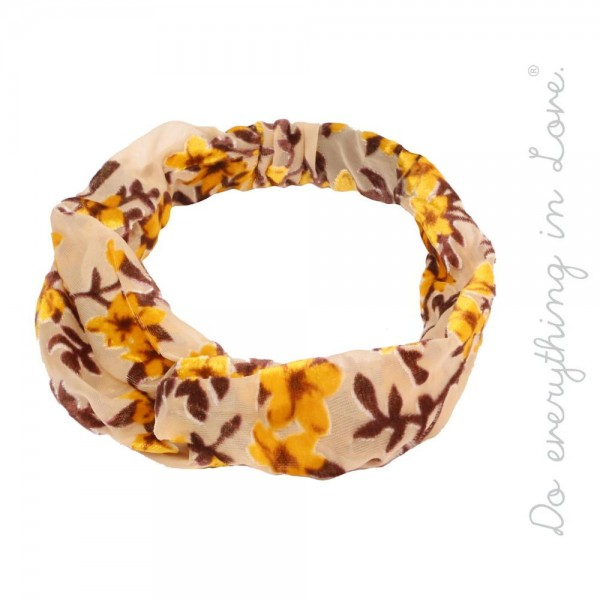 Do everything in Love brand floral knotted headband.  - One size fits most adults - 100% Polyester