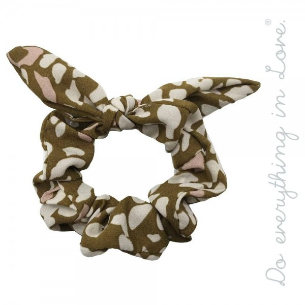 Do everything in Love brand leopard print bow hair scrunchie.  - One size - 100% Polyester