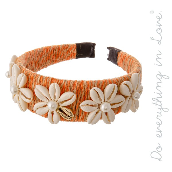 Do everything in Love Brand Two Tone Twine Wrapped Headband with Flower Puka Shell Details and Pearl Accents.  - One size fits most