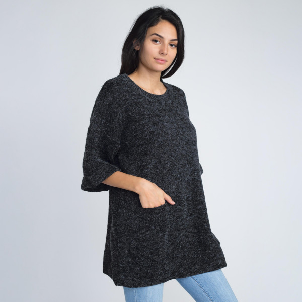 Heavyweight knitted short sleeve sweater with pocket details.    - One size fits most 0-14 - 55% Acrylic, 45% Cotton