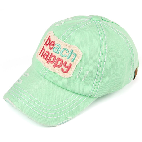 "Ponytail baseball cap that reads, ""Beach Happy."" 