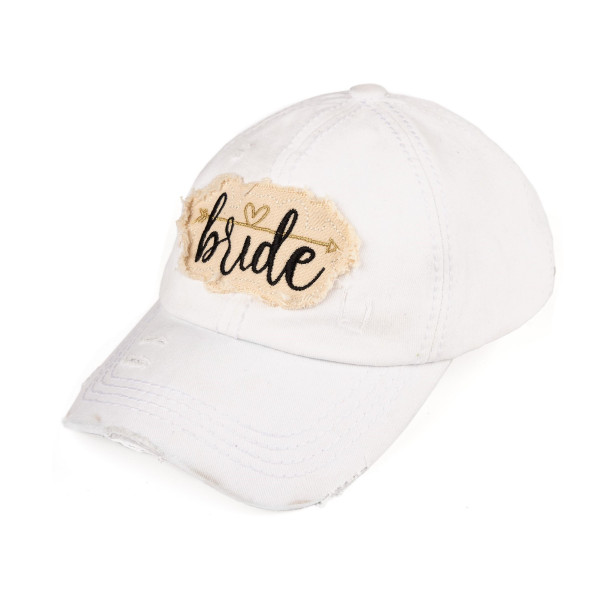 "C.C. BA-2018 distressed vintage style ""Bride"" baseball cap featuring embroidered heart and arrow detail. Velcro closure with embroidered accents. 100% Cotton. One size fits most."