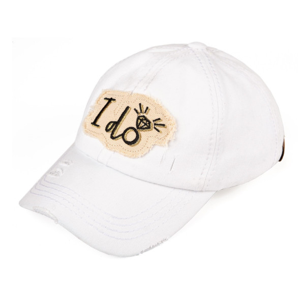 "C.C. BA-2018 distressed vintage style ""I Do"" baseball cap featuring embroidered heart and arrow detail. Velcro closure with embroidered accents. 100% Cotton. One size fits most."