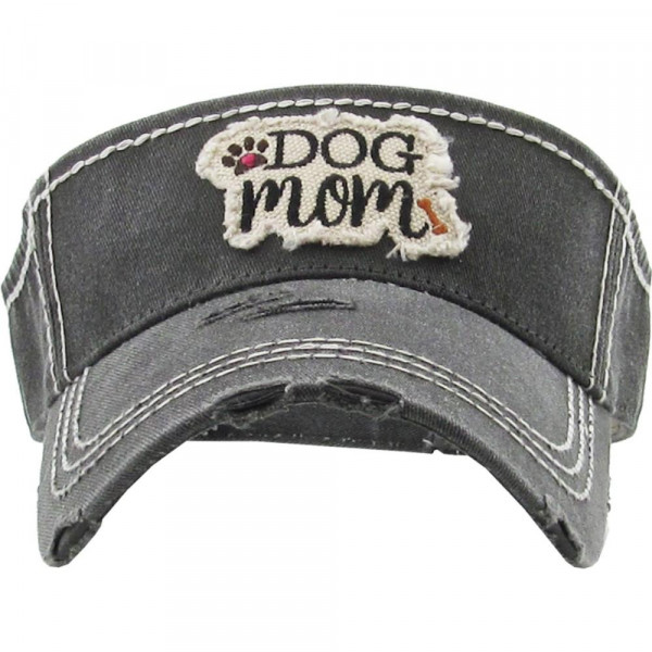 "Vintage, distressed visor featuring ""Dog Mom"" embroidered detail.   - 100% Cotton - Adjustable velcro closure - One size fits most"