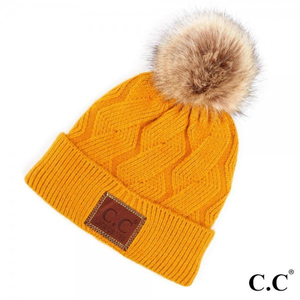 C.C HAT-2298  Geometric Cable Knit Faux Fur Pom Beanie.   - One size fits most - 100% Acrylic