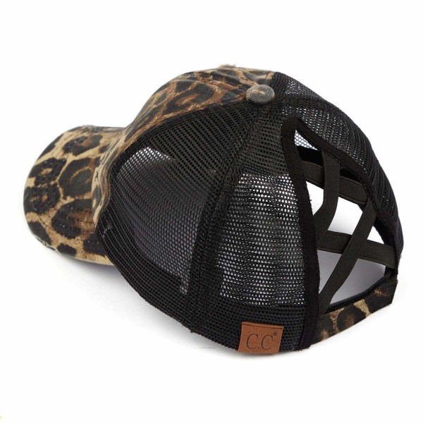 C.C Pony Cap BT-780 Distressed Leopard Print Criss Cross Pony Cap with Mesh Back   - One size fits most - Elastic criss cross pony tail opening  - Adjustable Velcro Closure - 60% Cotton / 40% Polyester