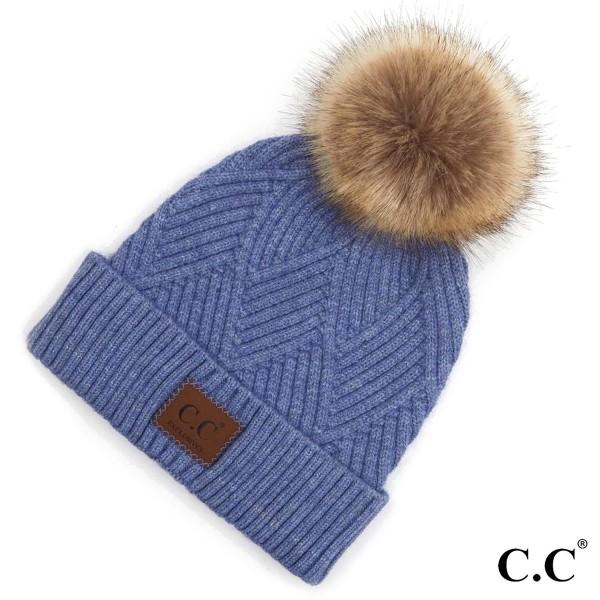 C.C HAT-2060 Diagonal Stripe Knit Pattern Pom Beanie with C.C Brand Leather Patch.  - One size fits most  - 47% Rayon / 31% PBT / 22% Nylon  - POM: 100% Faux Fur