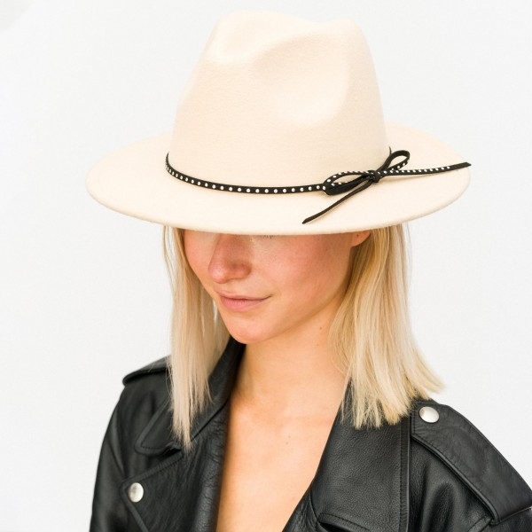 "Wool Felt Fedora Hat Featuring Studded Faux Leather Band Detail.  - One size fits most - Inside Adjustable Drawstring - Brim Width: 2.5"" - Inner Head Circumference 12""  - 100% Polyester"