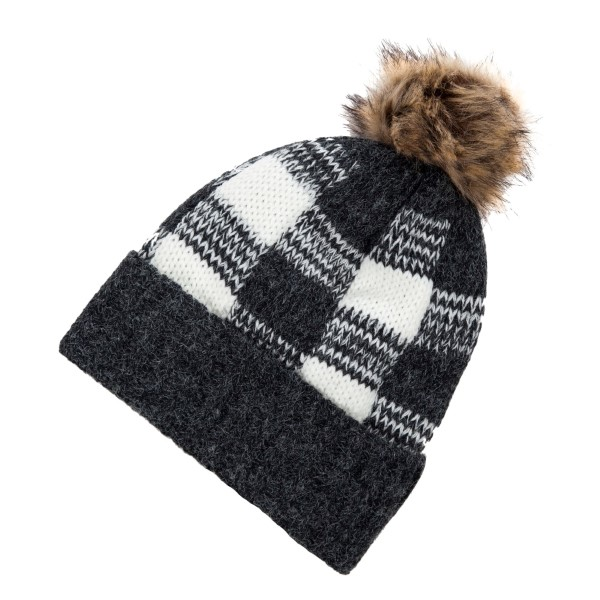 Black and white checked, fleece lined toboggan with a brown fur pom pom.