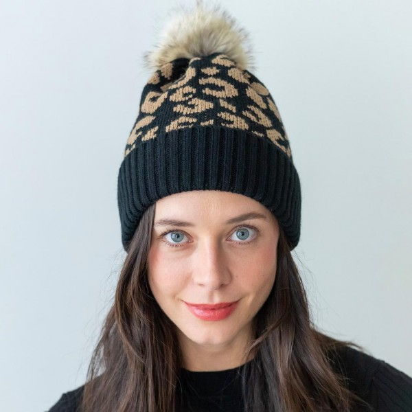 Leopard Print Beanie Featuring a Faux Fur Pom.   - One Size Fits Most - 100% Acrylic