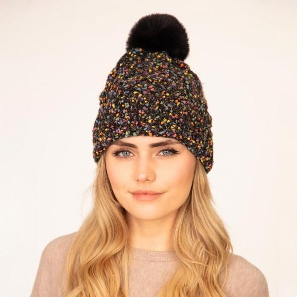 Knit beanie with faux fur pom pom  -One size fits most -48% Polyester/ 32% Acrylic/ 20% Nylon