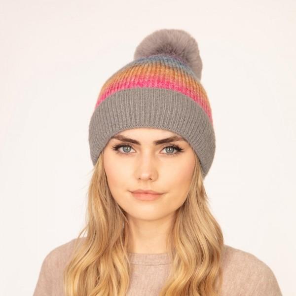 Knit beanie with faux fur pom pom  -One size fits most -Lined -80% Acrylic/20% Nylon