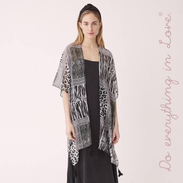"Do everything in Love brand lightweight multi animal print kimono with tassels.  - One size fits most 0-14 - Approximately 37"" L - 100% Polyester"
