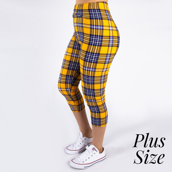 """PLUS SIZE peach skin plaid print capri style leggings. Inseam approximately 19"""".  - One size fits most 16-20  - Composition: 92% Polyester, 8% Spandex/Elasthanne"""