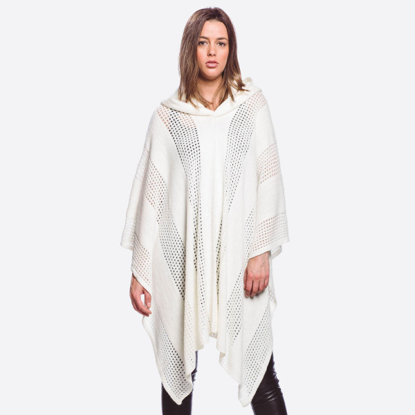 "Knit poncho featuring a hood with shark bite hem details.  - One size fits most 0-14 - Approximately 27"" in length - 100% Acrylic"