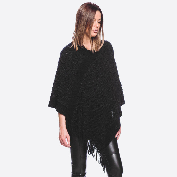 "Popcorn knit poncho with fringes.   - One size fits most 0-14 - Approximately 31"" in length - 40% Acrylic, 60% Polyester"