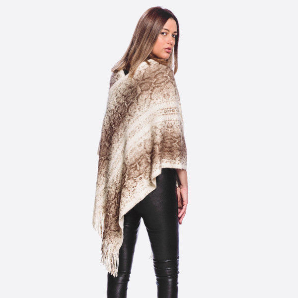 """Solid ribbed knit snakeskin poncho with fringes.  - One size fits most  - Approximately 35"""" in length  - Composition: 100% Acrylic"""