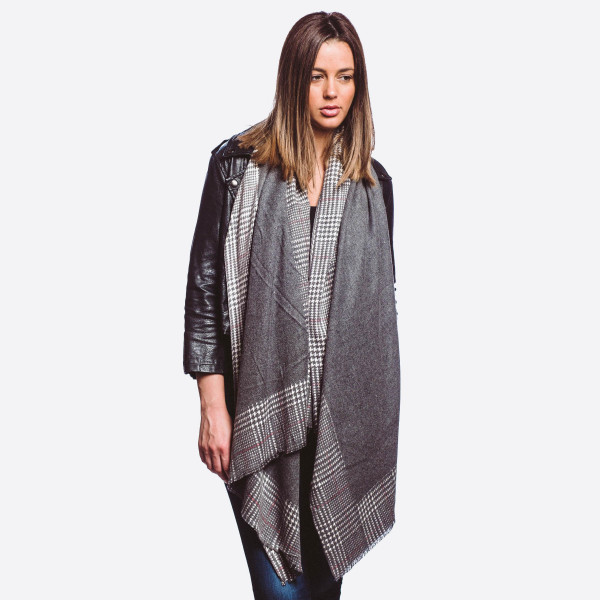 """Solid color oblong scarf with houndstooth border.  - Approximately 72"""" L  x 29"""" W  - 80% Cotton, 20% Cashmere"""