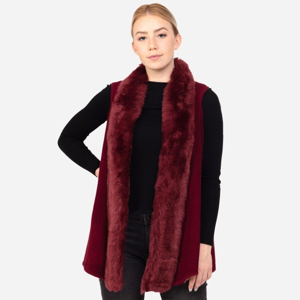 "Faux fur trimmed vest.  - One size fits most 0-14 - Approximately 35"" in length - 100% Acrylic"