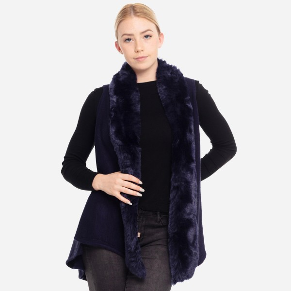 """Faux fur trimmed vest.  - One size fits most 0-14 - Approximately 35"""" in length - 100% Acrylic"""