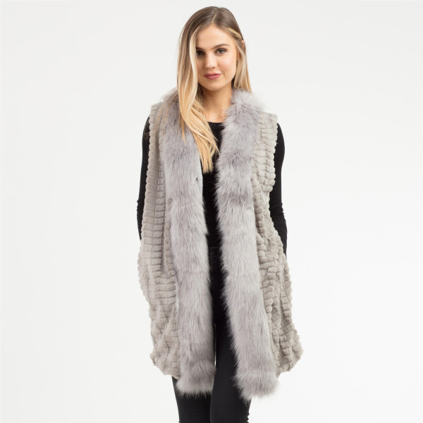 "Faux Fur Vest with Pockets.  - One size fits most 0-14 - Approximately 31"" L - 100% Polyester"