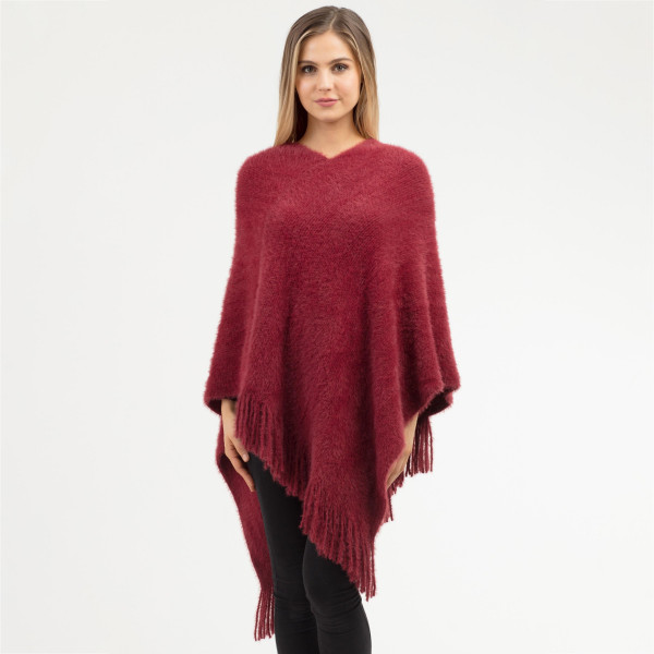 "Women's Soft Faux Fur Poncho Featuring Fringe Tassels.  - One size fits most 0-14 - Approximately 41"" L - 100% Acrylic"