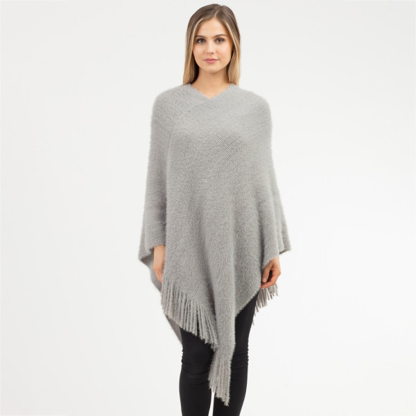 "Soft faux fur poncho with fringes.  - One size fits most 0-14 - Approximately 41"" in length - 100% Acrylic"