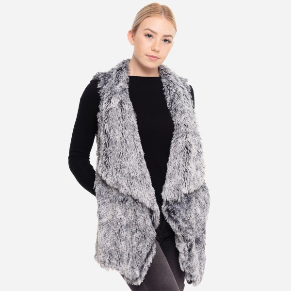 "Faux fur vest with pocket details.  - One size fits most 0-14 - Approximately 29"" in length - 100% Polyester"