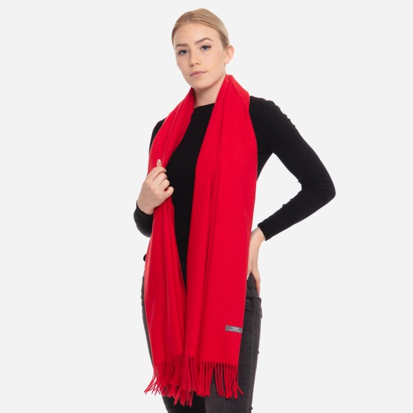 """Solid cashmere feel scarf with fringes.  - Approximately 28"""" W x 78"""" L - 100% Viscose"""