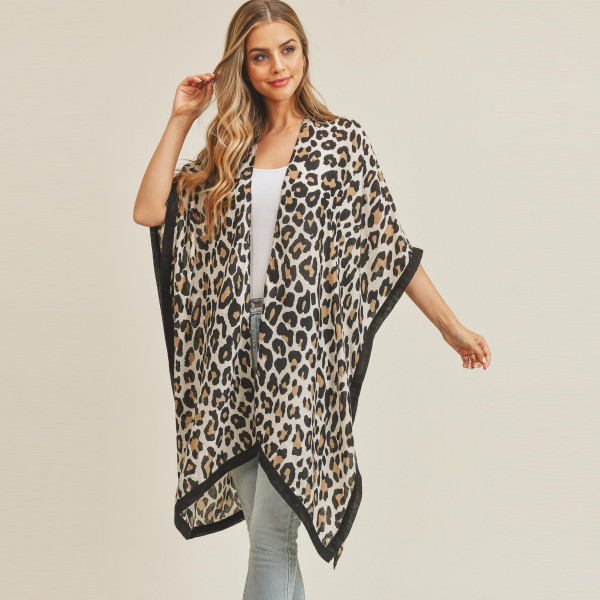 "Women's Lightweight Leopard Print Kimono.  - Approximately 60"" L  - 100% Polyester"