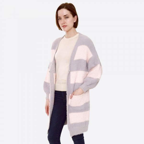 """Color-block cardigan with front pocket details.   - One size fits most 0-14 - Approximately 35"""" in length - 80% Polyester, 20% Acrylic"""