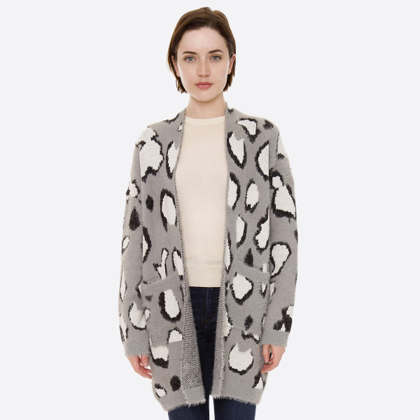 """Soft furry leopard print cardigan with front pocket details.  - One size fits most 0-14 - Approximately 30"""" in length - 70% Acrylic, 30% Polyester"""