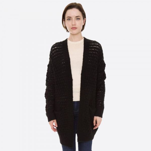 "Crochet inspired cardigan with front pocket details.  - One size fits most - Approximately 28"" in length - 55% Acrylic, 25% Polyester, 17% Nylon, 3% Spandex"