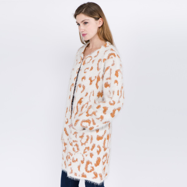 "Fuzzy leopard print cardigan with front pocket details.   - One size fits most 0-14 - Approximately 30"" in length - 100% Polyester"