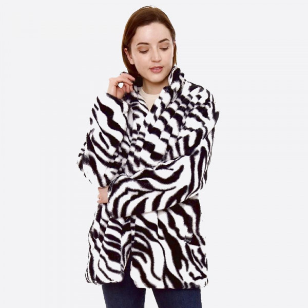 """Faux Fur Zebra Print Coat with Pockets.  - One size fits most 0-14 - Approximately 29"""" Long  - 100% Polyester"""