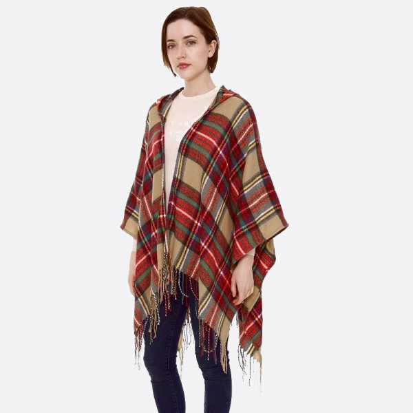 """Hooded plaid print ruana with fringes.  - One size fits most 0-14 - Approximately 32"""" L - 100% Acrylic"""