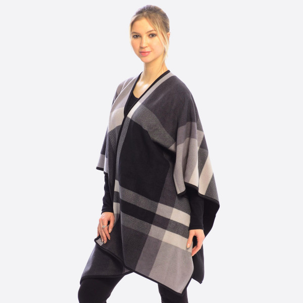 "Plaid fleece ruana/wrap.  - One size fits most 0-14 - Approximately 28"" in length. - 100% Polyester"