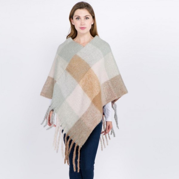 "Soft Fuzzy Knit Color Block Poncho Featuring Oversized Fringe Tassels.  - One size fits most 0-14 - Approximately 37"" L - 100% Acrylic"